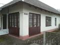 Продаётся кирпичный дом в центре города со всеми удобствами